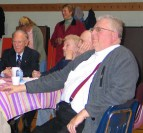 Fr. Smith enjoys the moment with John Coyne (L), and Mary and Ralph Cartwright