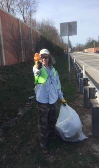 Tim Young finds a new friend during roadside cleanup April 21, 2018