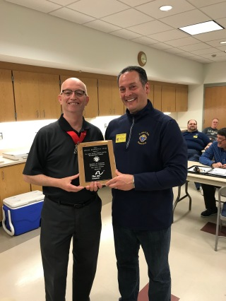 Dave Maginnis presents the award to Deputy Grand Knight Anthony Rosato